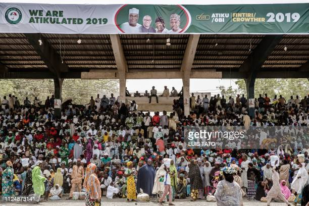 Supporters of the Nigeria's opposition party Peoples Democratic Party presidential candidate Atiku Abubakar attend a campaign rally at the Ribadu...
