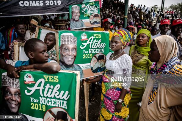 TOPSHOT Supporters of the Nigeria's opposition party Peoples Democratic Party presidential candidate Atiku Abubakar attend a campaign rally at the...