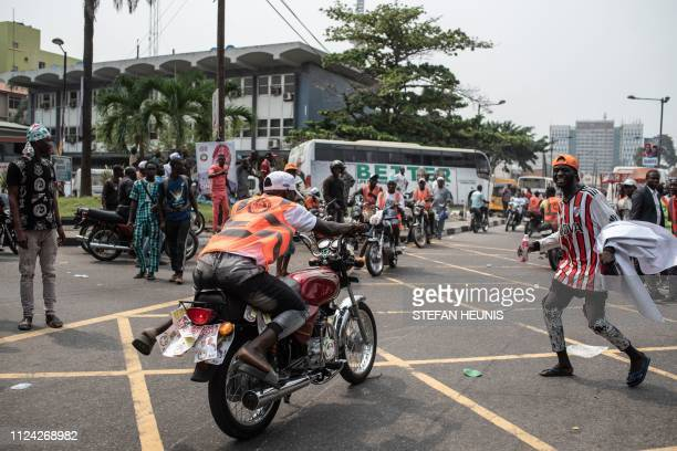 Supporters of the Nigeria's presidential candidate Atiku Abubakar for the main opposition party Peoples Democratic Party celebrate in the street by a...