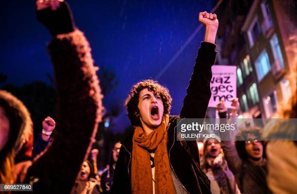 """Supporters of the """"No"""" gesture and chant slogans during a march at the Kadikoy district in Istanbul on April 17, 2017 to protest following the..."""