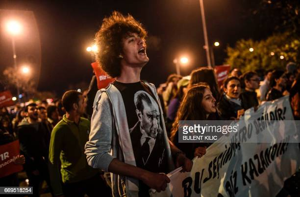 """Supporters of the """"No"""" gesture and shout as they gather at the Kadikoy district in Istanbul on April 17, 2017 to protest following the results in a..."""