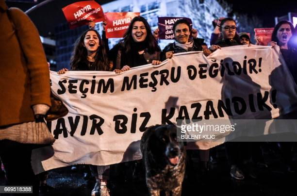"""Supporters of the """"No"""" hold a banner and march with a dog as they gather at the Kadikoy district in Istanbul on April 17, 2017 to protest following..."""