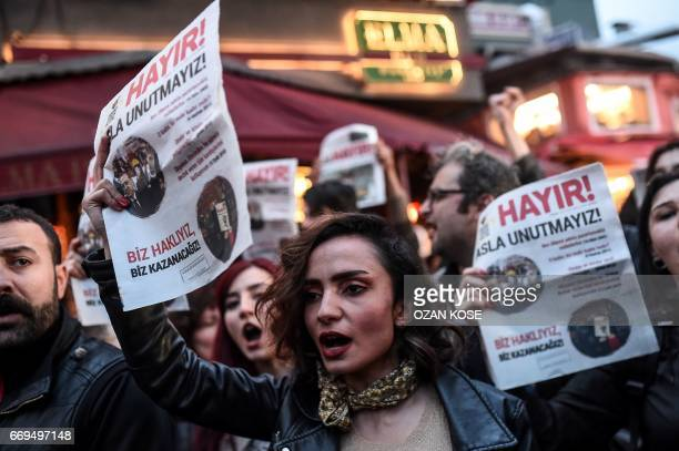 """Supporters of the """"No"""" hold leaflets reading """"no"""" as they gesture and shout while they gather at the Besiktas district in Istanbul on April 17, 2017..."""