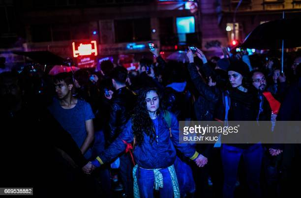 """Supporters of the """"No"""" march in the streets of the Kadikoy district in Istanbul on April 17, 2017 to protest following the results in a nationwide..."""