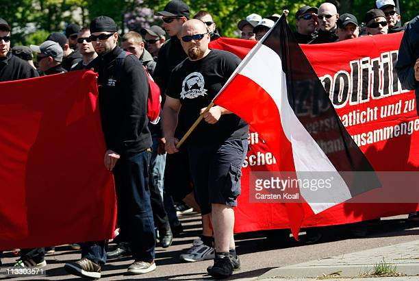 Supporters of the NPD German rightwing political party protest during an NPD May Day gathering on May 1 2011 in Halle Germany May Day demonstrations...