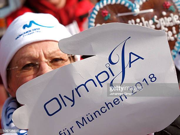 Supporters of the Olympic games demonstrate with placards reading 'OlympiJa' in front of cross country venue Gut Schwaiganger on March 2, 2011 in...