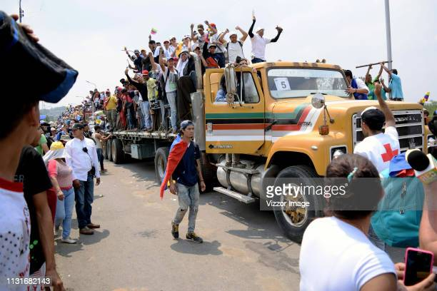 Supporters of the opposition arrive in a truck during the attempt to admit humanitarian aid to Venezuela at the Francisco de Paula Santander bridge...