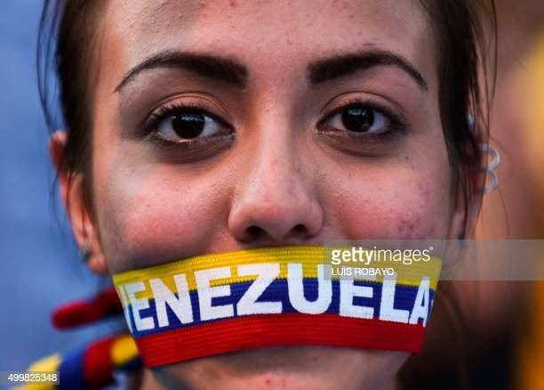Supporters of the opposition Movement of Democratic Unity party attend the campaign closing rally on December 3 2015 in Caracas Venezuela Polls...