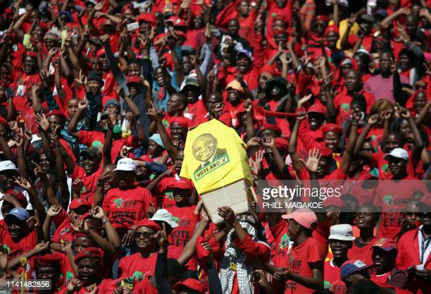 Supporters of the opposition party Economic Freedom Fighters hold a mock coffin bearing the face of the ruling African National Congress President...