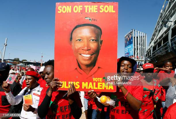 Supporters of the opposition party Economic Freedom Fighters hold a poster reflecting their leader Julius Malema during EFF final election rally at...