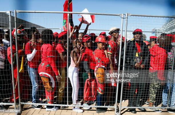Supporters of the opposition party Economic Freedom Fighters stand next to barricades as they arrive for EFF final election rally at Orlando Stadium...