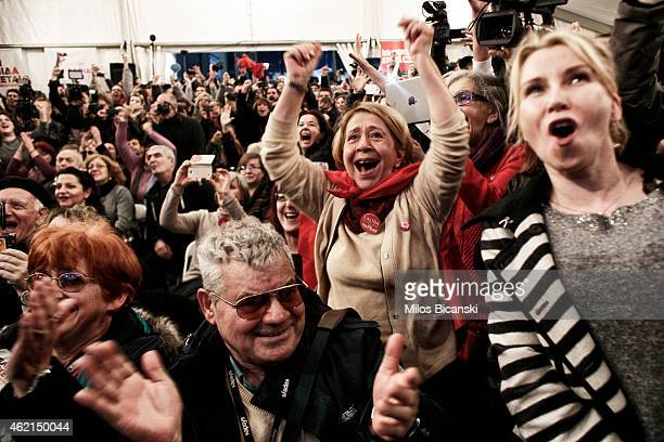 Supporters of the opposition radical leftist Syriza party cheer at exit poll results which indicate that Syriza have a clear lead on January 25, 2015...