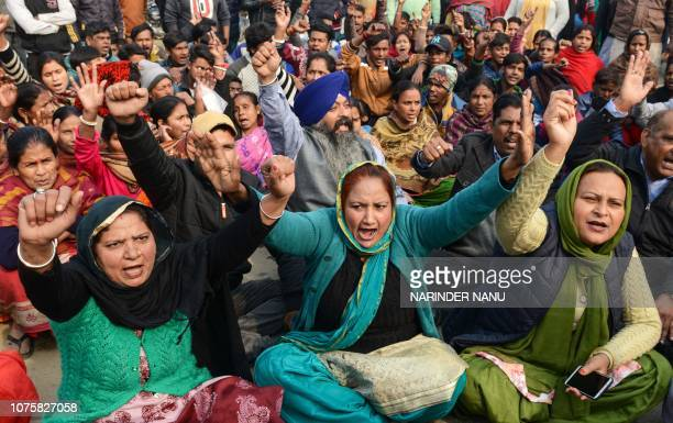 Supporters of the opposition Shiromani Akali Dal party block road traffic as they protest against the Punjab government and police for allegedly...
