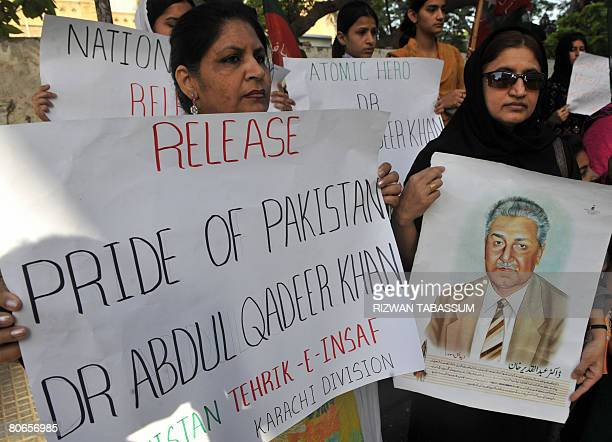 Supporters of the Pakistan Movement for Justice party protest calling for the release of disgraced scientist Abdul Qadeer Khan in Karachi on April 13...