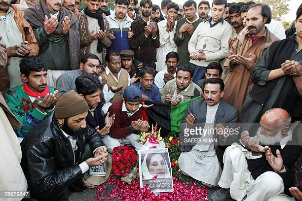 Supporters of the Pakistan People's Party hold a candle vigil at the site of the assassination of former premier Benazir Bhutto in Rawalpindi 30...
