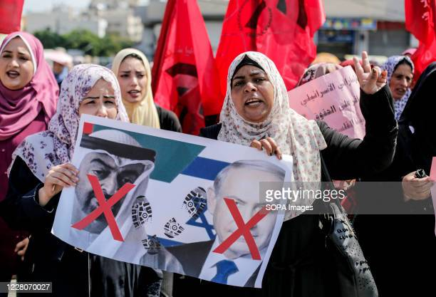 Supporters of the Palestinian Democratic Front chant slogans during the demonstration Protest against the agreement to establish diplomatic relations...