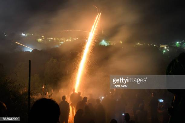 Supporters of the Panaghia Erithiani Church fire rockets from homemade racks at the Aghios Marko Church during the annual Rocket War known locally as...