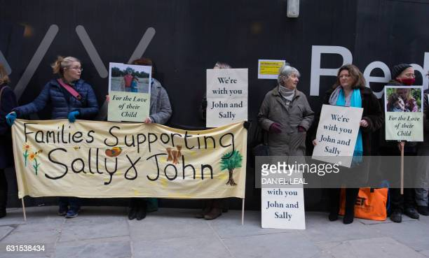 Supporters of the parents of Jack Letts who is believed to have left the UK to join Islamic State hold banners outside the Old Bailey in central...
