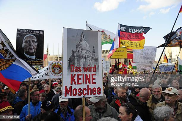 Supporters of the PEGIDA movement attend a rally on April 18 2016 in Dresden The banner reads 'It wil not be a mosque' Lutz Bachmann the founder of...