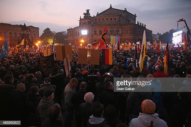 Supporters of the Pegida movement gather at Theaterplatz square on the first anniversary since the first Pegida march on October 19 2015 in Dresden...