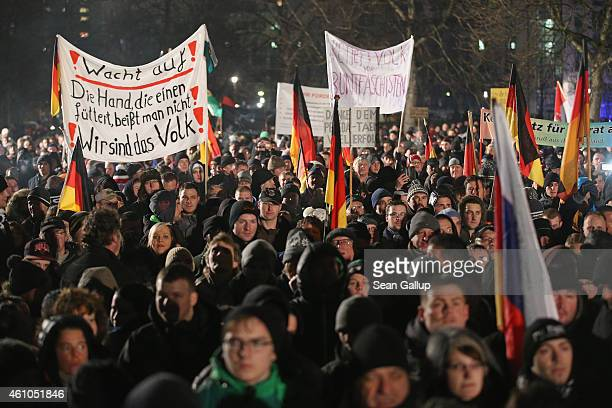 Supporters of the Pegida movement gather for another of their weekly protests on January 5 2015 in Dresden Germany Pegida is an acronym for...