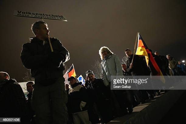 Supporters of the Pegida movement march at another of their weekly gatherings on December 15 2014 in Dresden Germany Pegida is an acronym for...