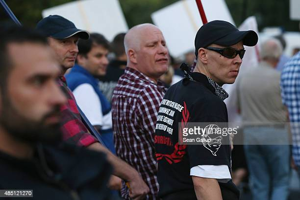 Supporters of the Pegida movement march past the Reichstag on August 24 2015 in Berlin Germany Pegida is critical of Islam and many of its supporters...
