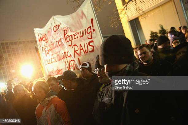Supporters of the Pegida movement protest at another of their weekly gatherings on December 15 2014 in Dresden Germany Pegida is an acronym for...
