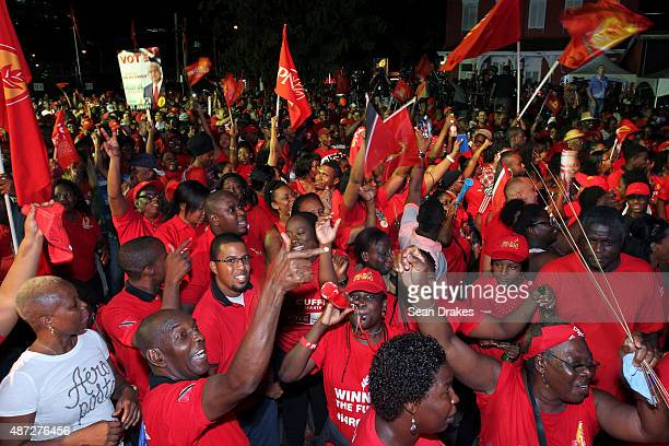 2015 Supporters of the People's National Movement celebrate at Balisier House after winning the majority constituencies and seats in the House of...