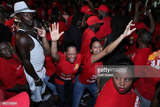 2015 Supporters of the People's National Movement celebrate at Balisier House after the PNM won the majority constituencies and seats in the House of...