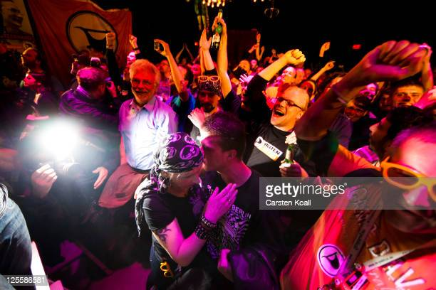 Supporters of the Piratenpartei celebrate the first results of the Berlin city election on September 18 2011 in Berlin Germany Preelection polls show...