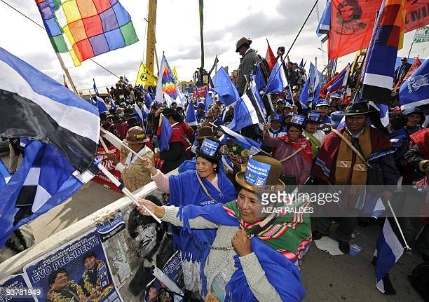 Supporters of the political party Movement to Socialism hold banners during the closing rally of the campaign on December 3, 2009 in El Alto, 12 km...