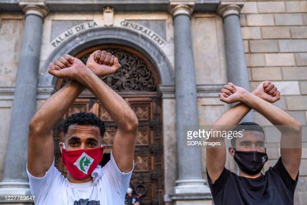 Supporters of the Popular Rif Movement wearing masks are seen crossing their arms as a sign of struggle for the independence of the Rif during the...