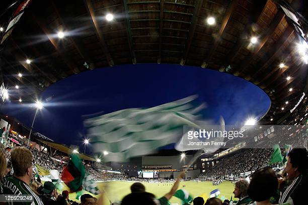 Supporters of the Portland Timbers wave flags against the San Jose Earthquakes on September 21 2011 at JeldWen Field in Portland Oregon