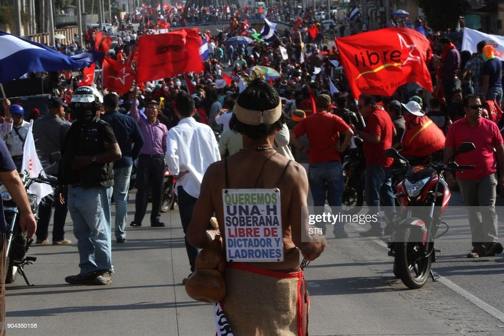 Supporters of the presidential candidate for the Honduran Opposition Alliance Against the Dictatorship, Salvador Nasralla, hold a protest in Tegucigalpa on January 12, 2018. Tens of thousands of people protested Friday in the Honduran capital against the reelection of President Juan Orlando Hernandez (JOH), as the January 27 start of his second term approaches. /