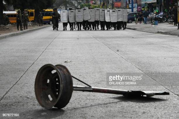 Supporters of the presidential candidate for the Honduran Opposition Alliance Against the Dictatorship Salvador Nasralla clash with riot police and...