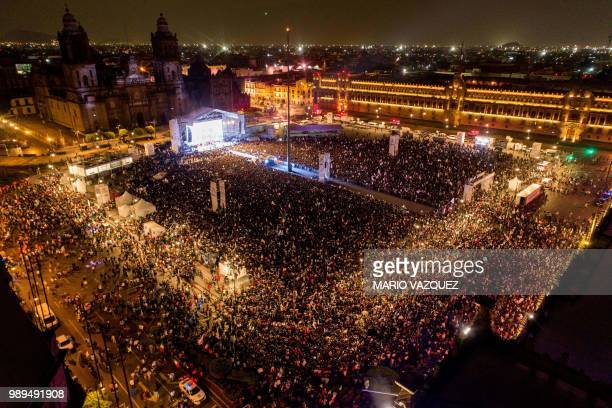 Supporters of the presidential candidate for the Juntos haremos historia coalition Andres Manuel Lopez Obrador celebrate at the Zocalo square in...