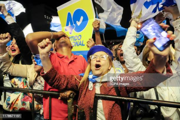 Supporters of the presidential candidate for the National Party Luis Lacalle Pou cheer up during his speech. The National party and the Frente Amplio...