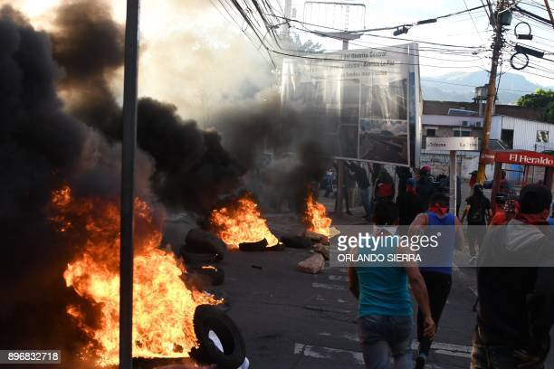TOPSHOT Supporters of the presidential candidate for the Opposition Alliance Against the Dictatorship Salvador Nasralla set fire to tires as they...