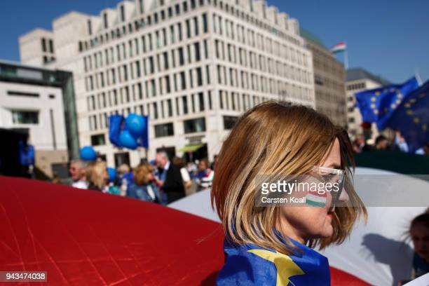 Supporters of the proEuropean Union movement Pulse of Europe wave EU flags as they gather in front of the Brandenburg Gate to express their support...