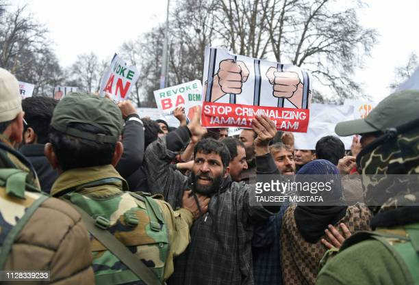 Supporters of the proIndian political party People's Democratic Party shout slogans during a protest in Srinagar on March 2 against the JamaateIslami...