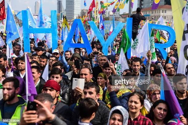 Supporters of the proKurdish opposition Peoples' Democratic Party and of the 'Hayir' campaign attend a rally for the upcoming referendum in Istanbul...