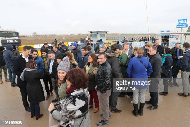 Supporters of the proKurdish party Peoples' Democratic Party wait in front the courthouse ahead of a protest calling for the release of their party's...