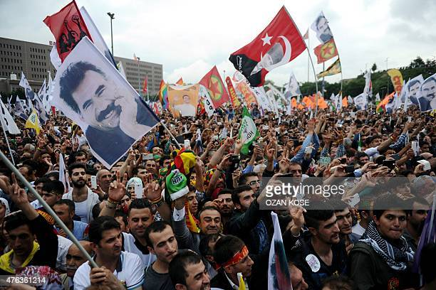 Supporters of the proKurdish People's Democratic Party hold pictures of Abdullah Ocalan jailed leader of the Kurdish Workers' Party and Mustafa Kemal...