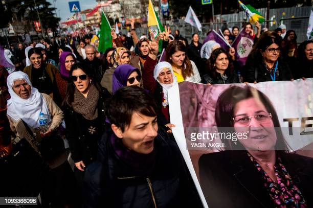 Supporters of the proKurdish Peoples' Democratic Party march with a picture of HDP lawmaker Leyla Guven as they attend a 'Peace and Justice' rally in...