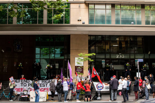 AUS: Protesters Rally In Support Of Refugee Advocate Chris Breen