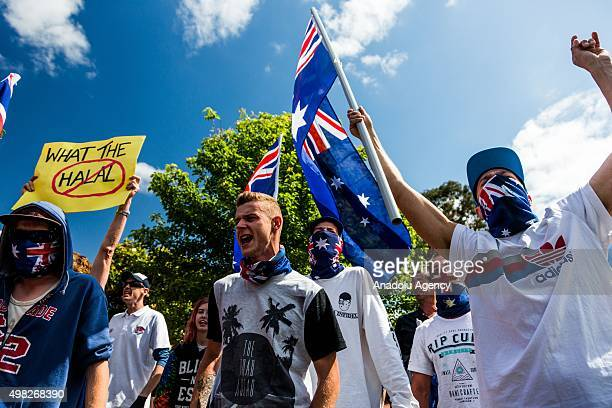 Supporters of the Reclaim Australia group march down the street waving flags and shouting anti-islamic slogans during a protest organized by the far...