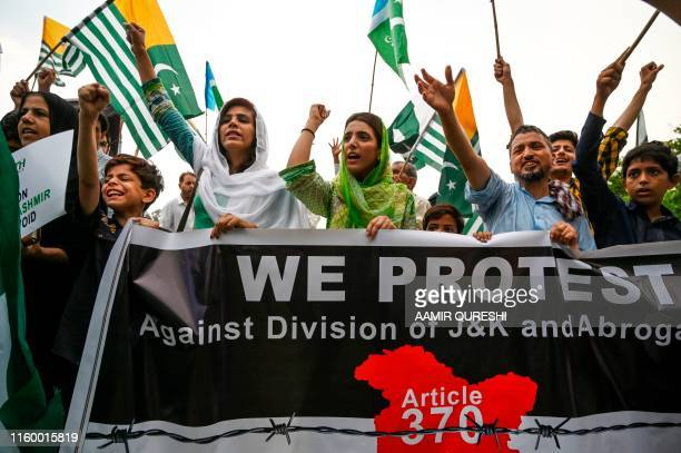Supporters of the religious political party JamaateIslami shout antiIndian slogans during a protest rally in Islamabad on August 6 a day after India...
