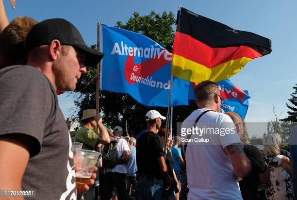 Supporters of the rightwing Alternative for Germany political party listen to AfD speakers campaigning for the AfD in Brandenburg state elections on...