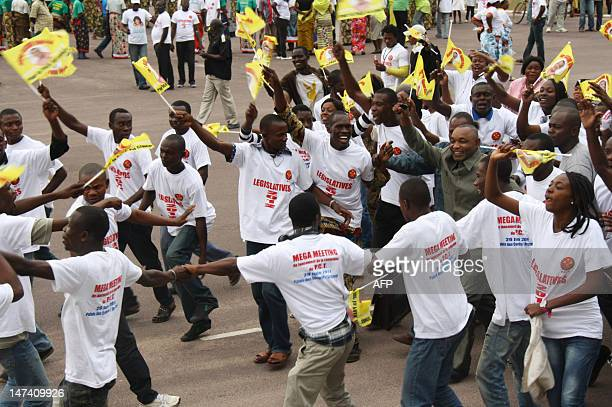 Supporters of the ruling Congolese Party of Labour party cheer Faustin Elenga one of the PCT candidates in the Talangai district during a political...